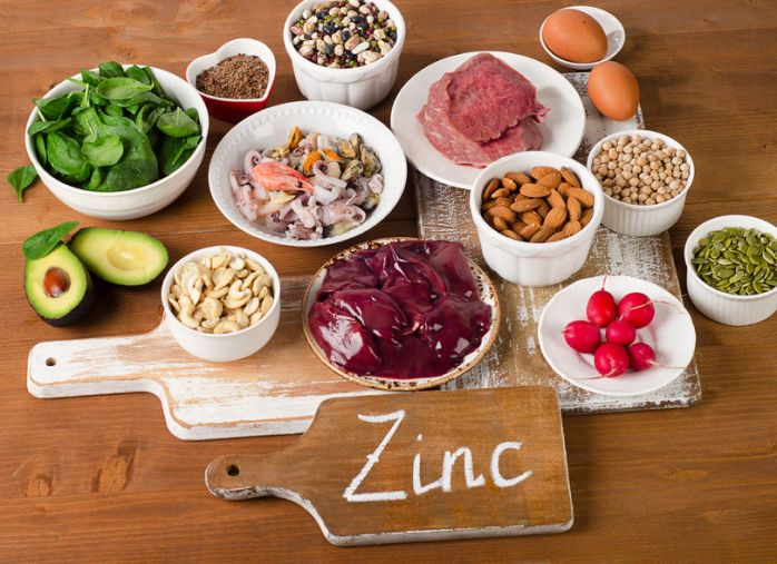 55559993 - foods with zinc mineral on a wooden table. top view